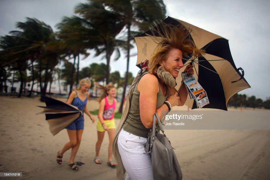 Laura Rath, on vacation from the Netherlands, walks on the beach with her family as they are buffeted by high winds of the outer bands of Hurricane Sandy on October 25, 2012 in Miami Beach, Florida. After passing over Jamaica Hurricane Sandy is expected to hit eastern Cuba and head into the Bahamas today and tomorrow. There is a tropical storm warning in place for coastal Miami-Dade, Broward, and Palm Beach Counties and the Atlantic waters off southeast Florida.
