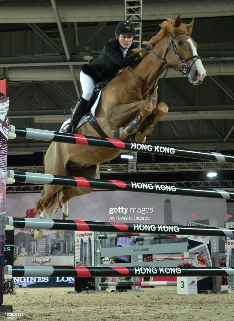 Laura Renwick of Britain riding Oz de Breve competes in the international jumping competition Grand Prix equestrian event in Hong Kong on March 2, 2013. AFP PHOTO / Antony DICKSON