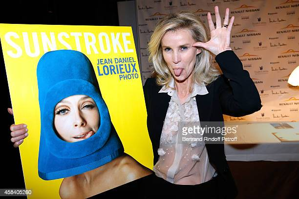 Laura Restelli attends JeanDaniel Lorieux signs his Book 'Sunstroke' at the Art Bookshop of the 'Royal Monceau Raffles Paris' on November 4 2014 in...