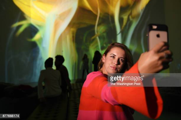 Laura Ritchie from Leesburg VA takes a selfie with her iPhone while visiting the Artechouse a combination of art and technology creations projected...