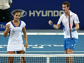 Laura Robson and Andy Murray of Great Britain celebrate a point in their mixed doubles match against Igor Andreev and Elena Dementieva of Russia in...