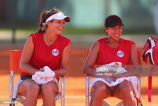 Laura Robson and Anne Keothavong of Great Britain share a joke in a practice session during previews ahead of the Fed Cup World Group Two PlayOffs...