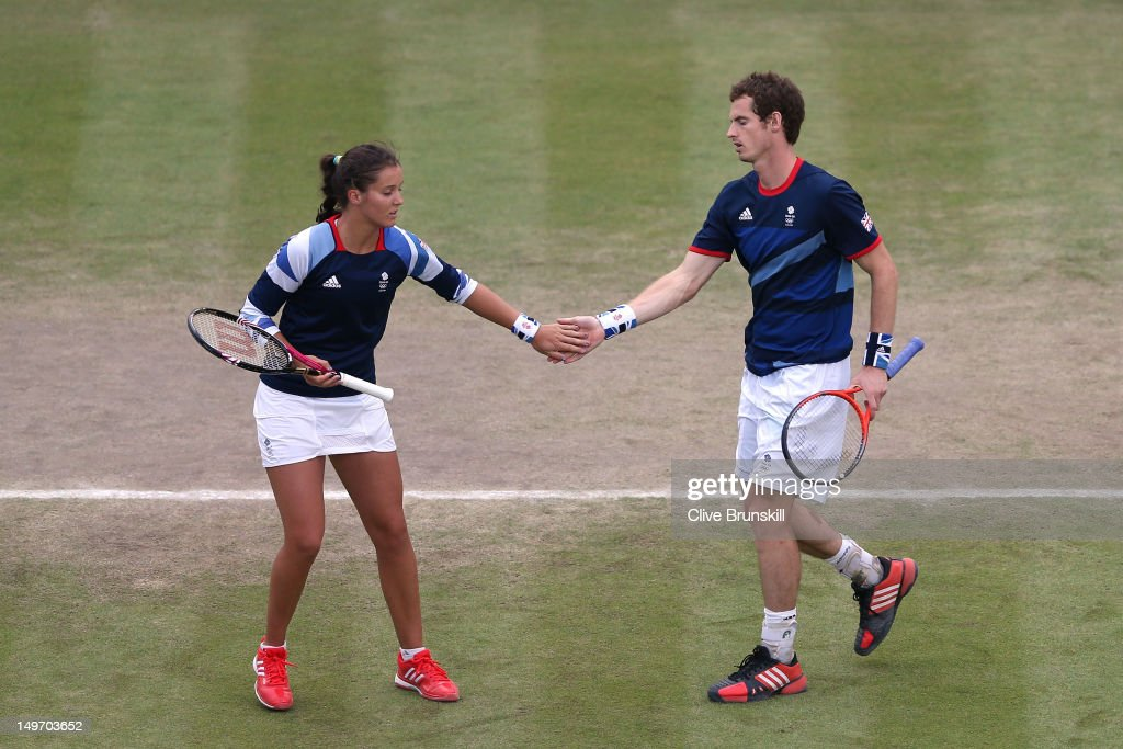 <a gi-track='captionPersonalityLinkClicked' href=/galleries/search?phrase=Laura+Robson&family=editorial&specificpeople=5421044 ng-click='$event.stopPropagation()'>Laura Robson</a> (L) high-fives teammate <a gi-track='captionPersonalityLinkClicked' href=/galleries/search?phrase=Andy+Murray+-+Tennis+Player&family=editorial&specificpeople=200668 ng-click='$event.stopPropagation()'>Andy Murray</a> (R) of Great Britain after a point against Lucie Hradecka and Radek Stepanek of Czech Republic during their first round Mixed Doubles Tennis match on Day 6 of the London 2012 Olympic Games at Wimbledon on August 2, 2012 in London, England.