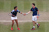 Laura Robson highfives teammate Andy Murray of Great Britain after a point against Lucie Hradecka and Radek Stepanek of Czech Republic during their...
