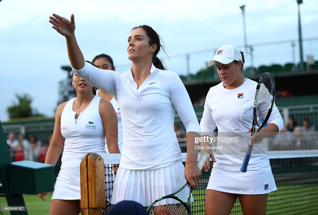 <a gi-track='captionPersonalityLinkClicked' href=/galleries/search?phrase=Laura+Robson&family=editorial&specificpeople=5421044 ng-click='$event.stopPropagation()'>Laura Robson</a> of Great Britain and <a gi-track='captionPersonalityLinkClicked' href=/galleries/search?phrase=Ashleigh+Barty&family=editorial&specificpeople=7369424 ng-click='$event.stopPropagation()'>Ashleigh Barty</a> of Australia walk off court following their defeat during the Ladies doubles first round match against Hao-Ching Chan and Yung-Jan Chan of Taipei on day four of the Wimbledon Lawn Tennis Championships at the All England Lawn Tennis and Croquet Club on June 30, 2016 in London, England.