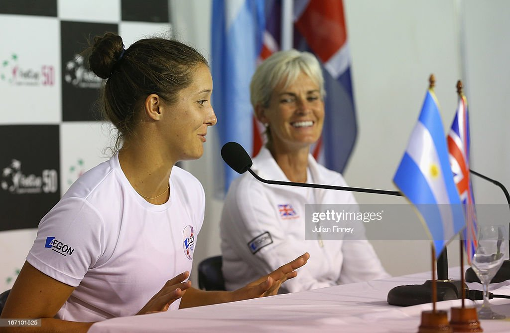 <a gi-track='captionPersonalityLinkClicked' href=/galleries/search?phrase=Laura+Robson&family=editorial&specificpeople=5421044 ng-click='$event.stopPropagation()'>Laura Robson</a> of Great Britain and Captain <a gi-track='captionPersonalityLinkClicked' href=/galleries/search?phrase=Judy+Murray&family=editorial&specificpeople=582324 ng-click='$event.stopPropagation()'>Judy Murray</a> talk to the media after play during day one of the Fed Cup World Group Two Play-Offs between Argentina and Great Britain at Parque Roca on April 20, 2013 in Buenos Aires, Argentina.