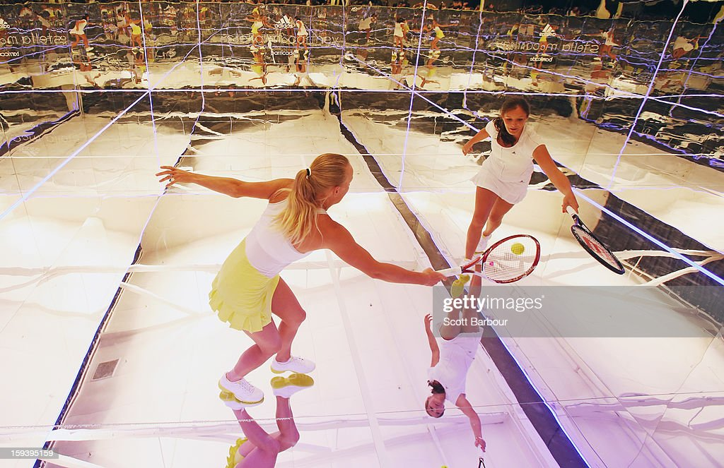 Laura Robson (R) of Great Britain and Caroline Wozniacki of Denmark play a game of tennis on a mirror court at the Adidas by Stella McCartney media launch on January 13, 2013 in Melbourne, Australia. To globally launch the first adidas by Stella McCartney collection tennis players Caroline Wozniacki, Maria Kirilenko and Laura Robson played tennis in the world's first mirror court.