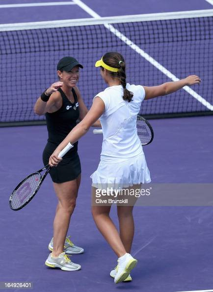 Laura Robson of Great Britain and Lisa Raymond celebrate match point against Sara Errani and Roberta Vinci of Italy during their semi final doubles...