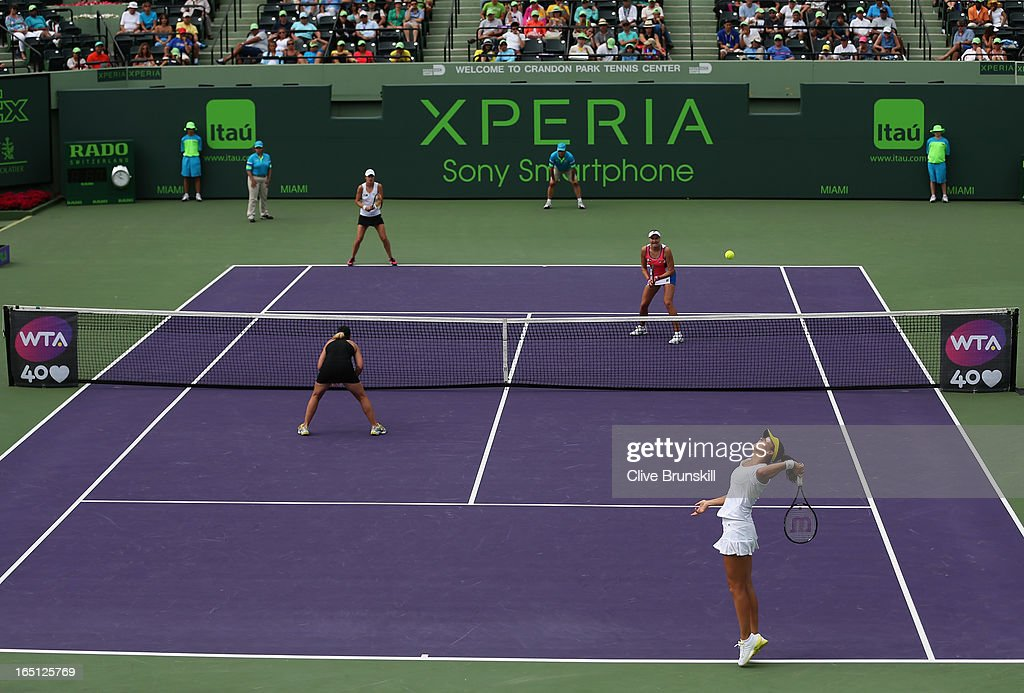Laura Robson of Great Britain and Lisa Raymond of the USA in action against Nadia Petrova of Russia and Katarina Strebotnik of Slovenia during their doubles final match at the Sony Open at Crandon Park Tennis Center on March 31, 2013 in Key Biscayne, Florida.