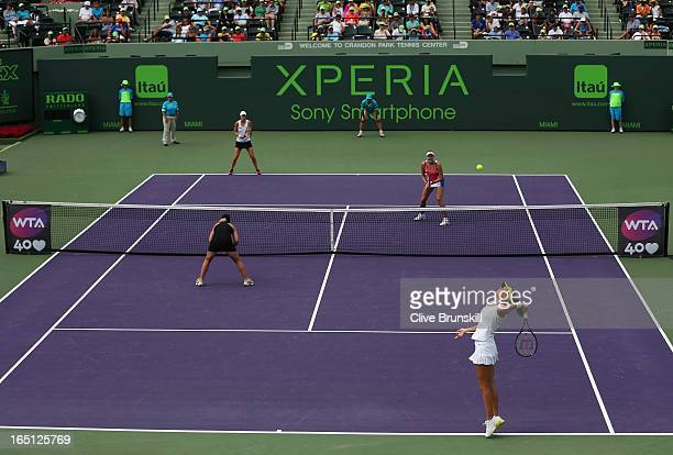 Laura Robson of Great Britain and Lisa Raymond of the USA in action against Nadia Petrova of Russia and Katarina Strebotnik of Slovenia during their...