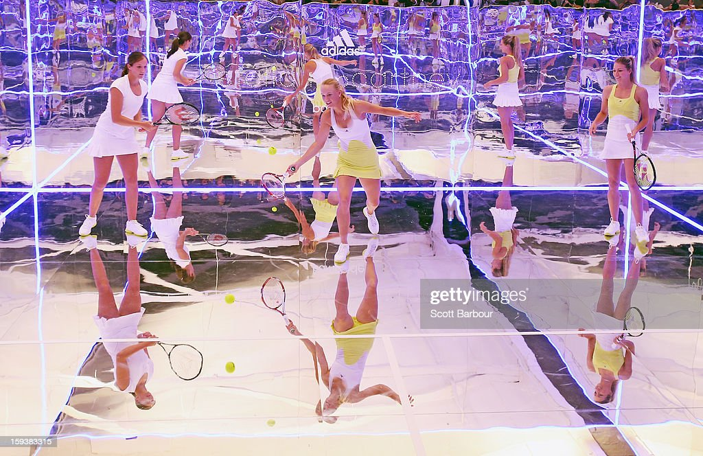 <a gi-track='captionPersonalityLinkClicked' href=/galleries/search?phrase=Laura+Robson&family=editorial&specificpeople=5421044 ng-click='$event.stopPropagation()'>Laura Robson</a> (L) of Great Britain and <a gi-track='captionPersonalityLinkClicked' href=/galleries/search?phrase=Maria+Kirilenko&family=editorial&specificpeople=211512 ng-click='$event.stopPropagation()'>Maria Kirilenko</a> (R) of Russia watch as <a gi-track='captionPersonalityLinkClicked' href=/galleries/search?phrase=Caroline+Wozniacki&family=editorial&specificpeople=740679 ng-click='$event.stopPropagation()'>Caroline Wozniacki</a> of Denmark plays a shot on a mirror court at the Adidas by Stella McCartney media launch on January 13, 2013 in Melbourne, Australia. To globally launch the first adidas by Stella McCartney collection tennis players <a gi-track='captionPersonalityLinkClicked' href=/galleries/search?phrase=Caroline+Wozniacki&family=editorial&specificpeople=740679 ng-click='$event.stopPropagation()'>Caroline Wozniacki</a>, <a gi-track='captionPersonalityLinkClicked' href=/galleries/search?phrase=Maria+Kirilenko&family=editorial&specificpeople=211512 ng-click='$event.stopPropagation()'>Maria Kirilenko</a> and <a gi-track='captionPersonalityLinkClicked' href=/galleries/search?phrase=Laura+Robson&family=editorial&specificpeople=5421044 ng-click='$event.stopPropagation()'>Laura Robson</a> played tennis in the world's first mirror court.