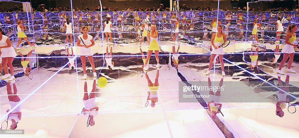 Laura Robson (L) of Great Britain and Maria Kirilenko (R) of Russia watch as Caroline Wozniacki (C) of Denmark plays a shot on a mirror court at the Adidas by Stella McCartney media launch on January 13, 2013 in Melbourne, Australia. To globally launch the first adidas by Stella McCartney collection tennis players Caroline Wozniacki, Maria Kirilenko and Laura Robson played tennis in the world's first mirror court.