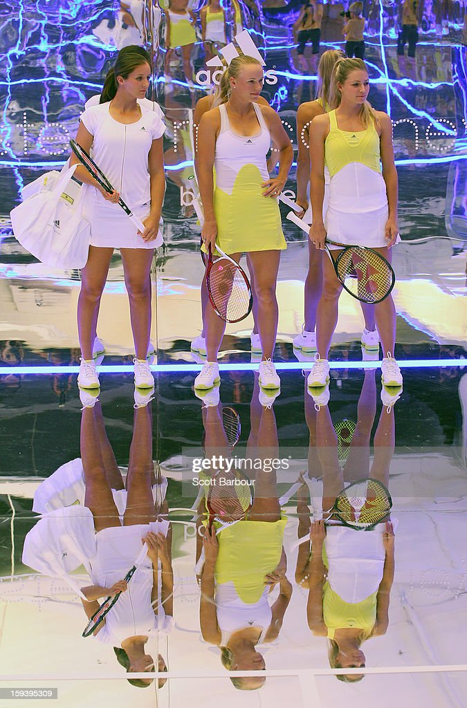 Laura Robson (L) of Great Britain, Caroline Wozniacki (C) of Denmark and and Maria Kirilenko (R) of Russia look on at the Adidas by Stella McCartney media launch on January 13, 2013 in Melbourne, Australia. To globally launch the first adidas by Stella McCartney collection tennis players Caroline Wozniacki, Maria Kirilenko and Laura Robson played tennis in the world's first mirror court.