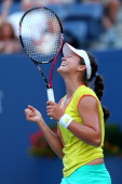 Laura Robson of Great Britain celebrates match point against Kim Clijsters of Belgium after their women's singles second round match Day Three of the...