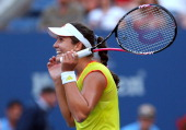 Laura Robson of Great Britain celebrates match point against Kim Clijsters of Belgium after their women's singles second round match on Day Three of...