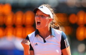 Laura Robson of Great Britain celebrates winning a point in her match against Florencia Molinero of Argentina during day one of the Fed Cup World...