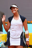Laura Robson of Great Britain celebrates winning her match against Agnieszka Radwanska of Poland during day three of the Mutua Madrid Open tennis...