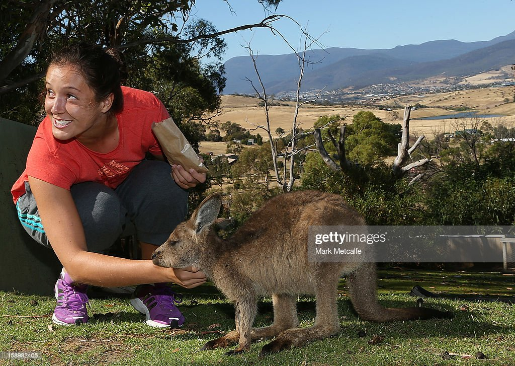 Laura Robson of Great Britain feeds a joey at Bonorong Wildlife Sanctuary during day two of the Hobart International at Domain Tennis Centre on January 5, 2013 in Hobart, Australia.