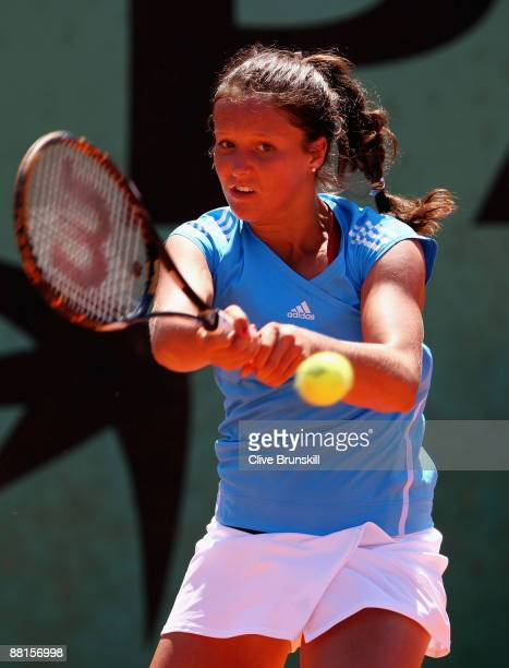 Laura Robson of Great Britain hits a backhand during the Girl's Singles Second Round match against Sandra Zaniewska of Poland on day ten of the...