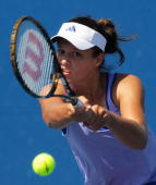 Laura Robson of Great Britain hits a backhand in her Women's Qualifying second round match against Michaella Krajicek of the Netherlands ahead of the...