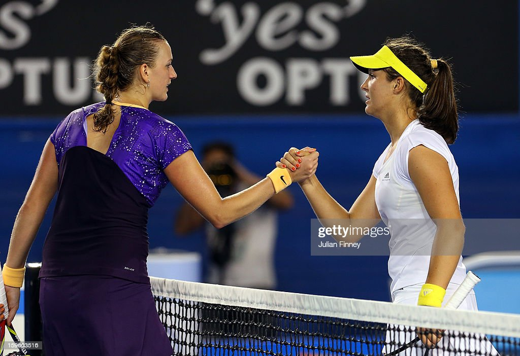 Laura Robson of Great Britain is congratulated by Petra Kvitova of Czech Republic after her second round match against Petra Kvitova of Czech Republic during day four of the 2013 Australian Open at Melbourne Park on January 17, 2013 in Melbourne, Australia.