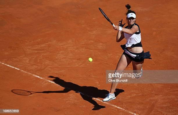 Laura Robson of Great Britain leaps to hit the final point against Venus Williams of the USA in their first round match during day two of the...