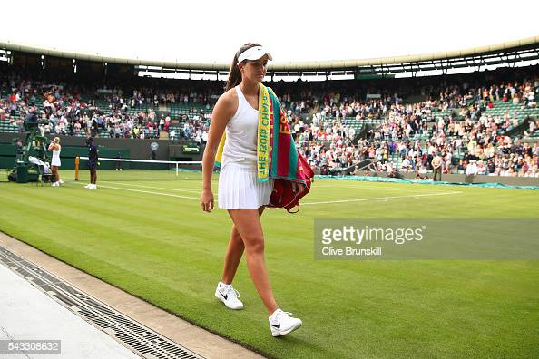 Laura Robson of Great Britain looks on as she leaves court one following defeat in the Ladies Singles first round match against Angelique Kerber of...