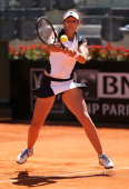 Laura Robson of Great Britain plays a backhand against Venus Williams of the USA in their first round match during day two of the Internazionali BNL...