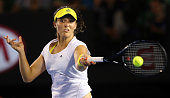 Laura Robson of Great Britain plays a forehand in her second round match against Petra Kvitova of Czech Republic during day four of the 2013...