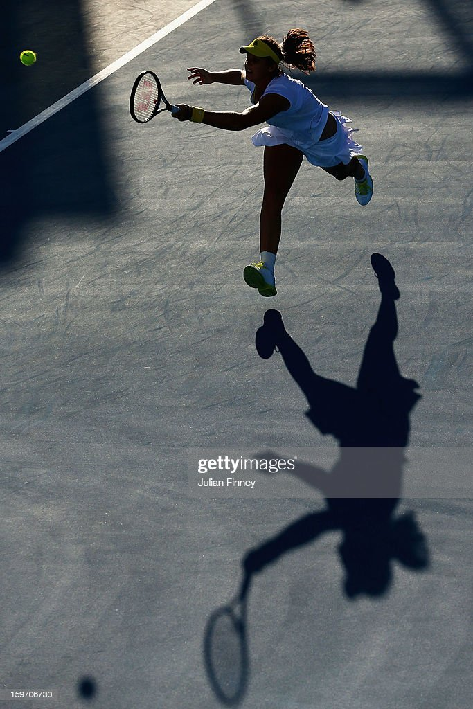 Laura Robson of Great Britain plays a forehand in her third round match against Sloane Stephens of the United States during day six of the 2013 Australian Open at Melbourne Park on January 19, 2013 in Melbourne, Australia.