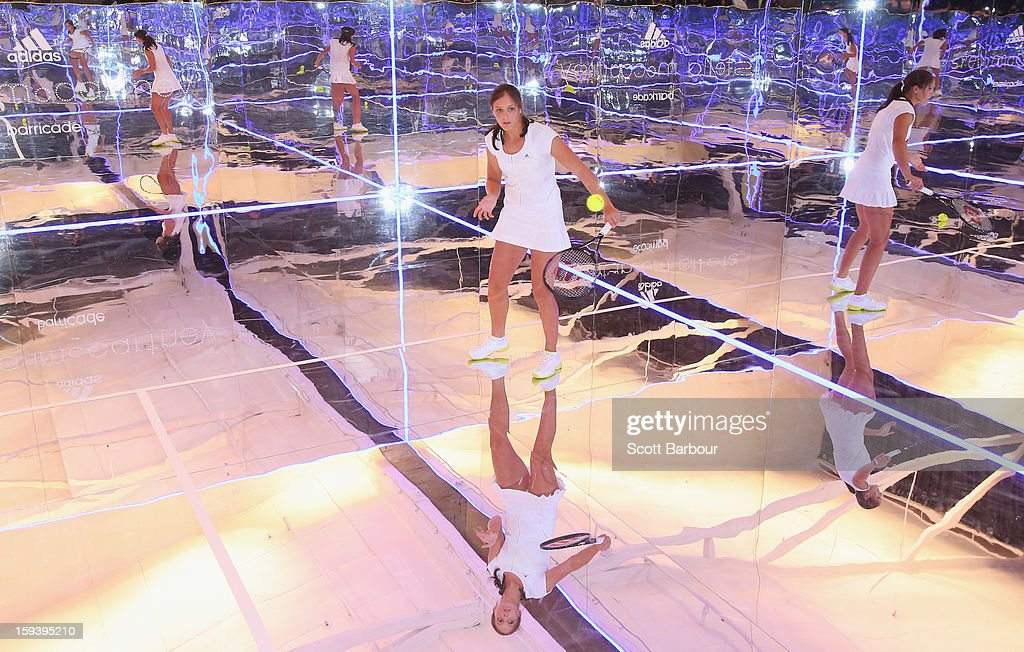 Laura Robson of Great Britain plays a game of tennis on a mirror court at the Adidas by Stella McCartney media launch on January 13, 2013 in Melbourne, Australia. To globally launch the first adidas by Stella McCartney collection tennis players Caroline Wozniacki, Maria Kirilenko and Laura Robson played tennis in the world's first mirror court.