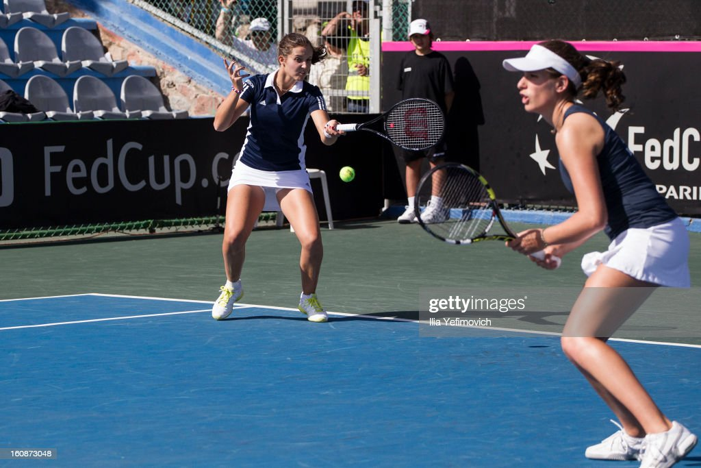 Laura Robson of Great Britain plays a shot in her match against Jelena Simic and Jasmina Kajtszovic during the tie between Great Britain and Bosnia and Herzegovina during the Fed Cup Europe/Africa Group One fixture at the Municipal Tennis Club on February 7, 2013 in Eilat, Israel.