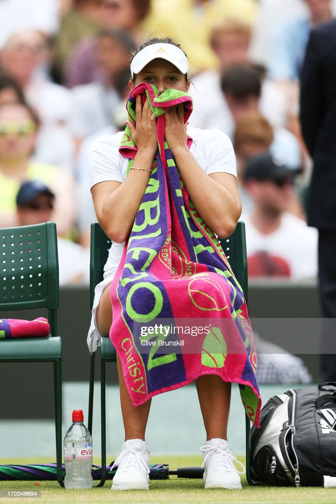 <a gi-track='captionPersonalityLinkClicked' href=/galleries/search?phrase=Laura+Robson&family=editorial&specificpeople=5421044 ng-click='$event.stopPropagation()'>Laura Robson</a> of Great Britain reacts during a break in her Ladies' Singles fourth round match against Kaia Kanepi of Estonia on day seven of the Wimbledon Lawn Tennis Championships at the All England Lawn Tennis and Croquet Club on July 1, 2013 in London, England.