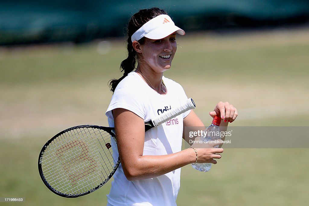 <a gi-track='captionPersonalityLinkClicked' href=/galleries/search?phrase=Laura+Robson&family=editorial&specificpeople=5421044 ng-click='$event.stopPropagation()'>Laura Robson</a> of Great Britain reacts during during a training session on Middle Sunday at Wimbledon on June 30, 2013 in London, England.
