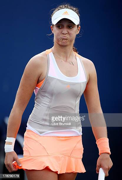 Laura Robson of Great Britain reacts during her women's singles second round match against Caroline Garcia of France on Day Three of the 2013 US Open...