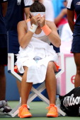 Laura Robson of Great Britain reacts during her women's singles third round match against Na Li of China on Day Five of the 2013 US Open at USTA...