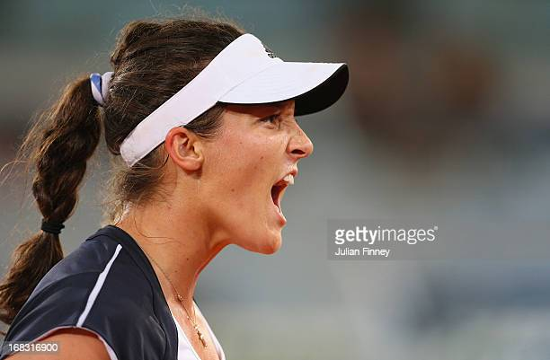 Laura Robson of Great Britain reacts in her match against Ana Ivanovic of Serbia during day five of the Mutua Madrid Open tennis tournament at the...