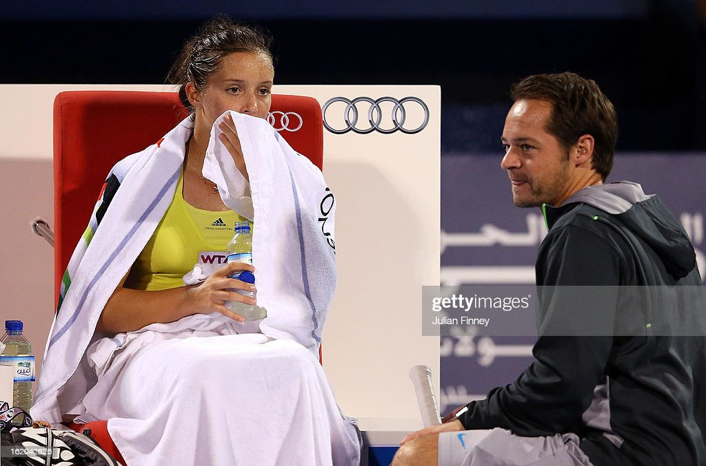 <a gi-track='captionPersonalityLinkClicked' href=/galleries/search?phrase=Laura+Robson&family=editorial&specificpeople=5421044 ng-click='$event.stopPropagation()'>Laura Robson</a> of Great Britain receives advice from coach, Zeljko Krajan in her match against Yulia Putintseva of Kazakhstan during day one of the WTA Dubai Duty Free Tennis Championship on February 18, 2013 in Dubai, United Arab Emirates.