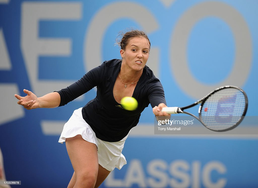 <a gi-track='captionPersonalityLinkClicked' href=/galleries/search?phrase=Laura+Robson&family=editorial&specificpeople=5421044 ng-click='$event.stopPropagation()'>Laura Robson</a> of Great Britain returns a shot during her doubles match with Lisa Raymond of USA against Cara Black of Zimbabwe and Marina Erakovic of New Zealand during The AEGON Classic Tennis Tournament at Edgbaston Priory Club on June 11, 2013 in Birmingham, England.
