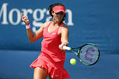 Laura Robson of Great Britain returns a shot to Elena Vesnina of Russia during their Women's Singles First Round match on Day Two of the 2015 US Open...