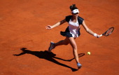 Laura Robson of Great Britain runs to play a forehand against Venus Williams of the USA in their first round match during day two of the...