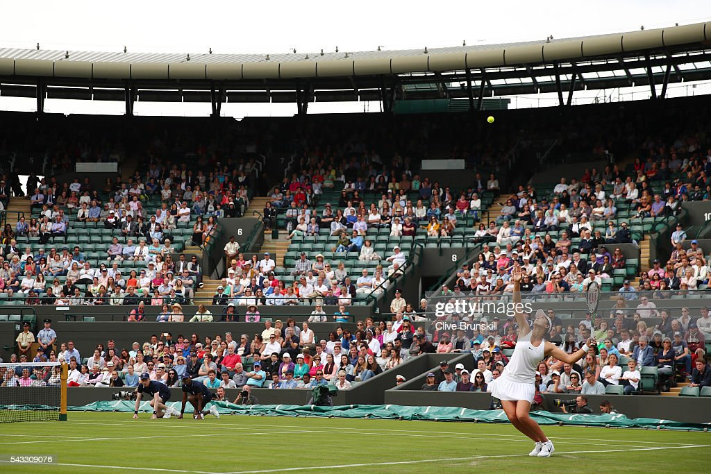 <a gi-track='captionPersonalityLinkClicked' href=/galleries/search?phrase=Laura+Robson&family=editorial&specificpeople=5421044 ng-click='$event.stopPropagation()'>Laura Robson</a> of Great Britain serves during the Ladies Singles first round match against Angelique Kerber of Germany on day one of the Wimbledon Lawn Tennis Championships at the All England Lawn Tennis and Croquet Club on June 27th, 2016 in London, England.
