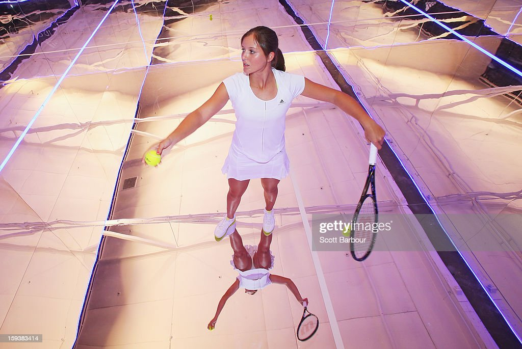 Laura Robson of Great Britain serves on a mirror court at the Adidas by Stella McCartney media launch on January 13, 2013 in Melbourne, Australia. To globally launch the first adidas by Stella McCartney collection tennis players Caroline Wozniacki, Maria Kirilenko and Laura Robson played tennis in the world's first mirror court.