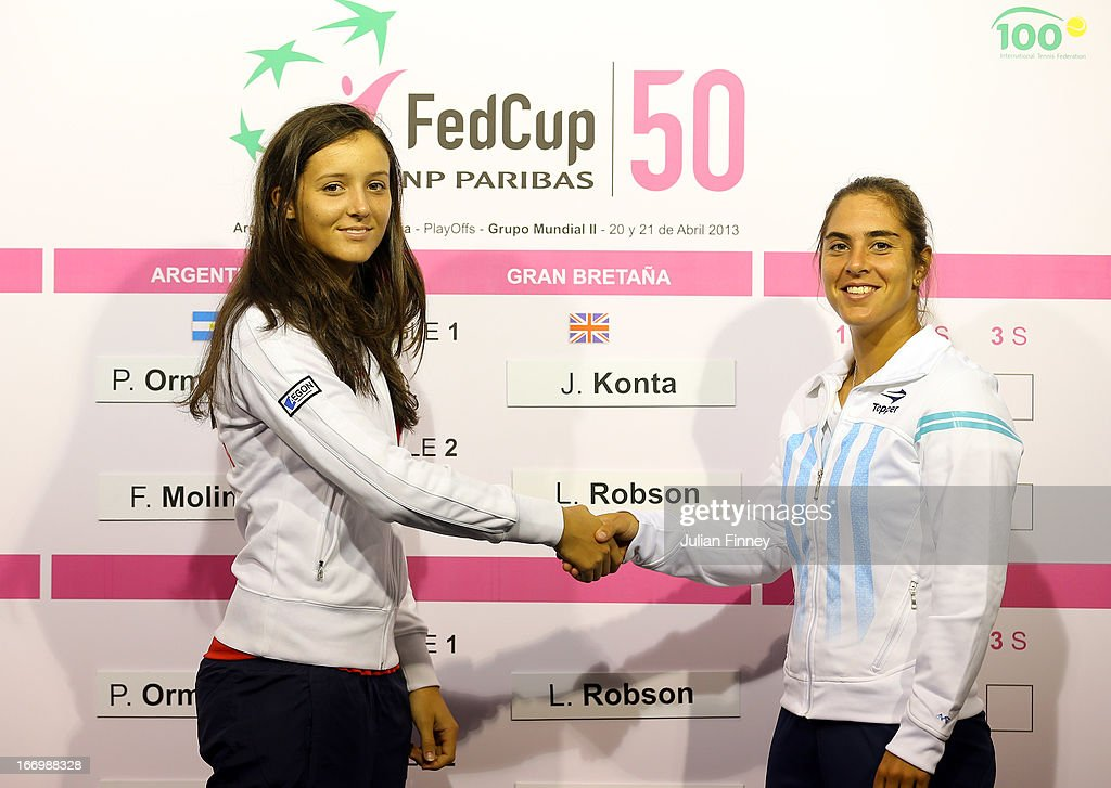 Laura Robson of Great Britain shakes hands with her first match oponent Florencia Molinero of Argentina during previews ahead of the Fed Cup World Group Two Play-Offs between Argentina and Great Britain at Parque Roca on April 19, 2013 in Buenos Aires, Argentina.
