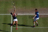 Laura Robson of Great Britain smashes the ball next to her partner Andy Murray of Great Britain during the Mixed Doubles Tennis gold medal match...