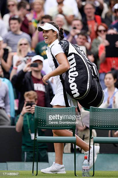 Laura Robson of Great Britain smiles as she leaves the court following her victory in the Ladies' Singles first round match against Maria Kirilenko...