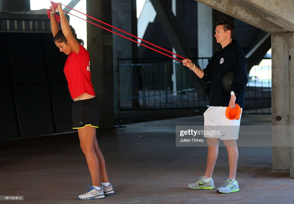 <a gi-track='captionPersonalityLinkClicked' href=/galleries/search?phrase=Laura+Robson&family=editorial&specificpeople=5421044 ng-click='$event.stopPropagation()'>Laura Robson</a> of Great Britain stretches before play during day one of the Fed Cup World Group Two Play-Offs between Argentina and Great Britain at Parque Roca on April 20, 2013 in Buenos Aires, Argentina.