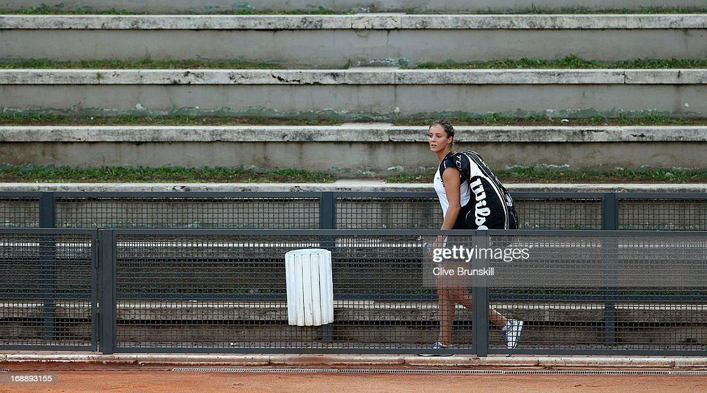 <a gi-track='captionPersonalityLinkClicked' href=/galleries/search?phrase=Laura+Robson&family=editorial&specificpeople=5421044 ng-click='$event.stopPropagation()'>Laura Robson</a> of Great Britain walks off court dejected after her straight sets defeat by Dominika Cibulkova of Slovakia and Monica Niculescu of Romania in their second round doubles match during day five of the Internazionali BNL d'Italia 2013 at the Foro Italico Tennis Centre on May 16, 2013 in Rome, Italy.