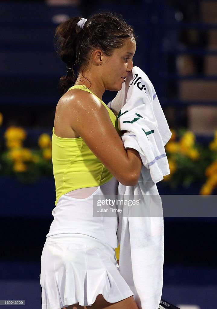 Laura Robson of Great Britain wipes her face with a towel in her match against Yulia Putintseva of Kazakhstan during day one of the WTA Dubai Duty Free Tennis Championship on February 18, 2013 in Dubai, United Arab Emirates.