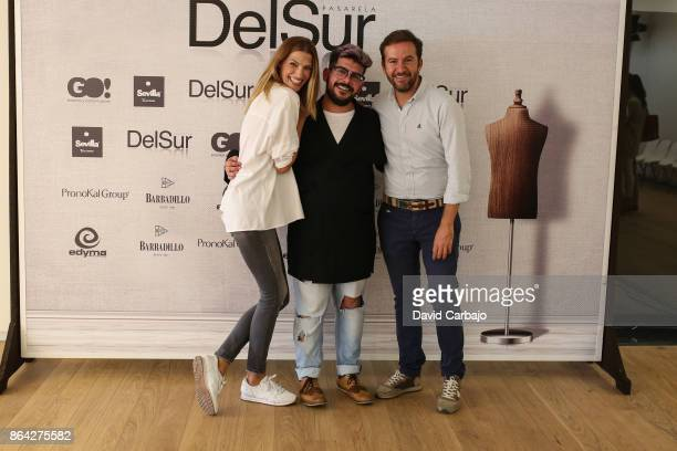 Laura Sanchez poses with designer Juan Velasco and event director Javier Villa in Pasarela del Sur on October 20 2017 in Seville Spain